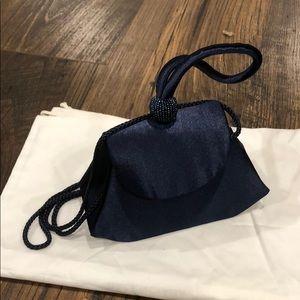 Caché Satin Clutch Bag